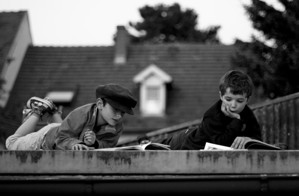 Children reading on the roof